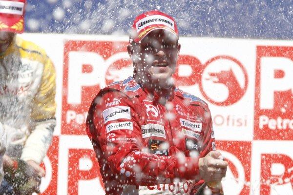 2007 GP2 Series. Round 8.Istanbul Park, Istanbul Turkey. 26th August 2007. Sunday Race.Adam Carroll (GBR, Petrol Ofisi FMS International) celebrates on the podium. World Copyright: Glenn Dunbar/GP2 Series Media Service.ref: Digital ImageIMG_5973