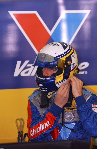 2004 DTM Championship Lausitzring. Germany. 4th - 6th june 2004. Peter Dumbreck (OPC Phoenix Opel Vectra GTS) puts on his helmet.World Copyright: Andre Irlmeier/LAT Photographic ref: Digital Image Only