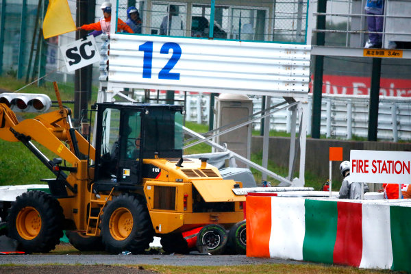 Suzuka Circuit, Suzuka, Japan. Sunday 5 October 2014. Jules Bianchi, Marussia MR03 Ferrari, crashes out of the race and receives urgent medical attention. World Copyright: Andrew Hone/LAT Photographic. ref: Digital Image _ONZ1807
