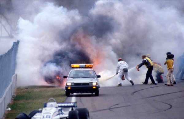 1982 Canadian Grand Prix. Montreal, Canada. 13 June 1982. Marshals try in vain to put out the fire that engulfed Riccardo Paletti, Osella FA1C-Ford, with fatal consequences. World Copyright: LAT Photographic Ref: 82CAN40