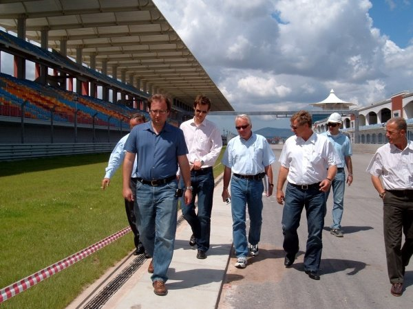 Charlie Whiting (GBR) FIA Race Director and Safety Delegate inspects the brand new Istanbul Park circuit 60 days before it's first F1 race. He is accompanied by Herman Tilke (GER) circuit architect, MŸmtaz Tahinciolu (TUR) President of the Turkish Automobile and Motor Sports Federation and officials of Formula Istanbul Investment Inc.Turkish Grand Prix Circuit Inspection, Istanbul, Turkey, 21 June 2005.DIGITAL IMAGE
