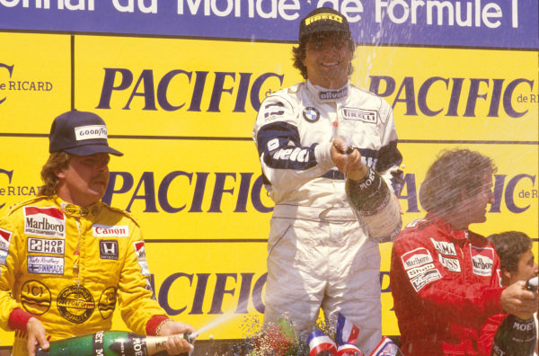Paul Ricard, Le Castellet, France. 5-7 July 1985. Nelson Piquet (Brabham BMW) 1st position, Keke Rosberg (Williams Honda) 2nd position and Alain Prost (McLaren TAG Porsche) 3rd position on the podium. First win for Pirelli tyres since 1957.  Ref-85 FRA 09. World Copyright - LAT Photographic
