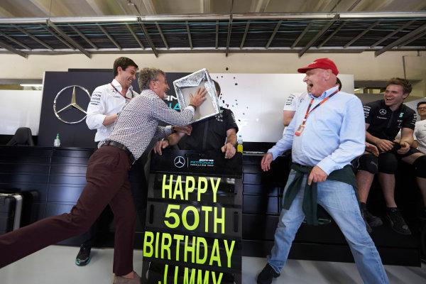Interlagos, Sao Paulo, Brazil. Saturday 14 November 2015. Eddie Jordan pushes a birthday cake in the face of Mercedes engineer Jimmy on his 50th. World Copyright: Steve Etherington/LAT Photographic ref: Digital Image SNE22095