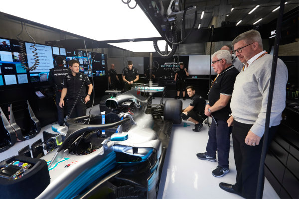 Spa Francorchamps, Belgium.  Friday 25 August 2017. Ross Brawn, Managing Director of Motorsports, FOM, and Jo Bauer, Technical Delegate, FIA, in the Mercedes garage timing entry and exit times of Lewis Hamilton, Mercedes F1 W08 EQ Power+, with the Halo device fitted. World Copyright: Steve Etherington/LAT Images  ref: Digital Image SNE10852