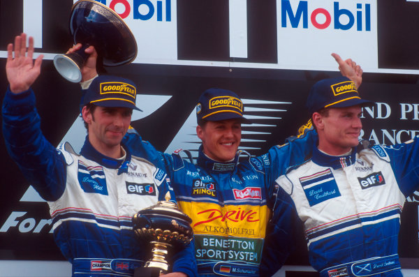 Magny-Cours, France.30/6-2/7 1995.Michael Schumacher (Benetton Renault) 1st position, Damon Hill (Williams Renault) 2nd position and David Coulthard (Williams Renault) 3rd position on the podium.Ref-95 FRA 03.World Copyright - LAT Photographic