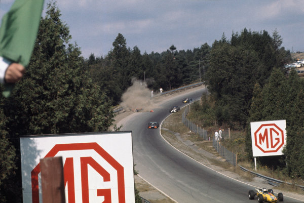 1969 Canadian Grand Prix.  Mosport, Canada. 18-20th September 1969.  Silvio Moser, Brabham BT24 Ford, crashes out on the first lap as Bill Brack, BRM P138, Pete Lovely, Lotus 49B Ford, and John Cordts, Brabham BT23B Climax, go past.  Ref: 69CAN02. World Copyright: LAT Photographic