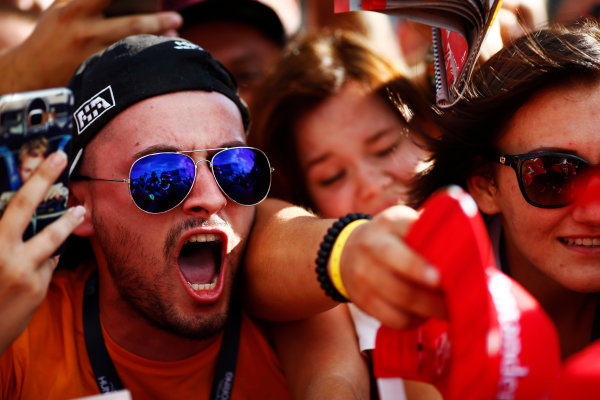 Hungaroring, Budapest, Hungary.  Thursday 27 July 2017. Kimi Raikkonen, Ferrari, signs autographs for excited fans. World Copyright: Andy Hone/LAT Images  ref: Digital Image _ONZ7773