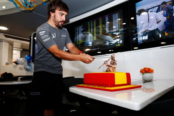 Hungaroring, Budapest, Hungary.  Saturday 29 July 2017. Fernando Alonso, McLaren, cuts his 36th birthday cake. World Copyright: Andy Hone/LAT Images  ref: Digital Image _ONZ9912