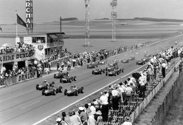 1961 French Grand Prix Reims, France. 30 June-2 July 1961 Wolfgang von Trips (#20) leads Phil Hill (#16), Richie Ginther (#18, all Ferrari 156) at the start. Eventual winner and debutant Giancarlo Baghetti (private Ferrari 156) can be seen centre towards the back of the grid World Copyright: LAT PhotographicRef: Autosport b&w print