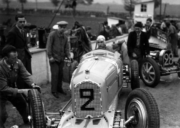 """1935 Picardie Grand Prix Peronne, France. 26 May 1935 Raymond Sommer, Alfa Romeo Tipo-B """"P3"""", 3rd position, is pushed onto the grid, portrait, helmet World Copyright: Robert Fellowes/LAT PhotographicRef: 35PIC09"""
