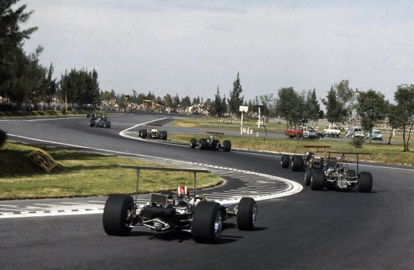 1968 Mexican Grand Prix.Mexico City, Mexico. 1-3 November 1968.Jo Siffert (Lotus 49B-Ford Cosworth) follows through The Esses on the opening lap.World Copyright: LAT PhotographicRef: 3503