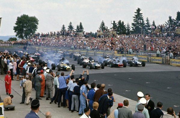 1967 German Grand Prix.Nurburgring, Germany. 6 August 1967.Jim Clark (Lotus 49-Ford Cosworth), Denny Hulme (Brabham BT24-Repco), Jackie Stewart (BRM P83) and Dan Gurney (Eagle T1G-Weslake) on the front row.World Copyright: LAT PhotographicRef: 67GER01