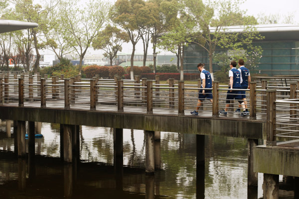 Shanghai International Circuit, Shanghai, China.  Thursday 06 April 2017. Williams team members cross a bridge behind the paddock. World Copyright: Steven Tee/LAT Images ref: Digital Image _R3I1333