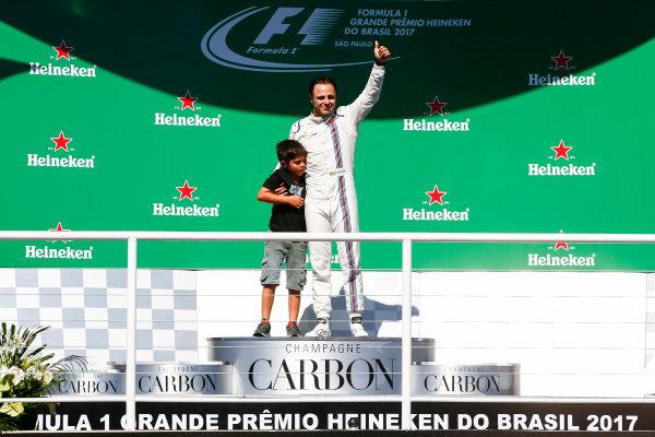 Interlagos, Sao Paulo, Brazil. Sunday 12 November 2017. Felipe Massa, Williams Martini Racing, waves to the fans from the podium with his son Felipinho. World Copyright: Andy Hone/LAT Images  ref: Digital Image _ONY9561