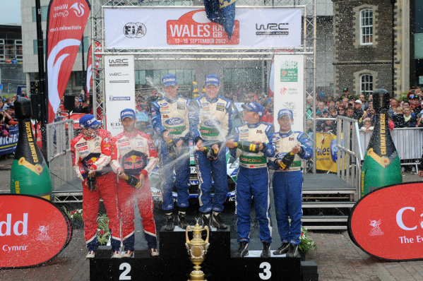 Podium (L to R): Second place finishers Sebastien Loeb (FRA) and Daniel Elena (MC), Citroen, rally winners Jari-Matti Latvala (FIN) and Miikka Anttila (FIN), Ford and third placed finishers Petter Solberg (NOR) and Chris Patterson (GBR), Ford with the champagne.FIA World Rally Championship, Rd10, Wales Rally GB, Day Three, Cardiff, Wales, 16 September 2012.