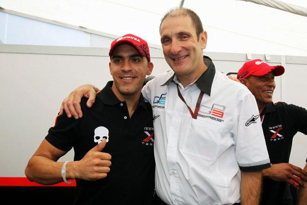 Pastor Maldonado (VEN) Rapax celebrates his GP2 Championship with Bruno Michel (FRA) GP2 Series CEO. GP2 Series, Rd 9, Race 2, Monza, Italy, Sunday 12 September 2010.