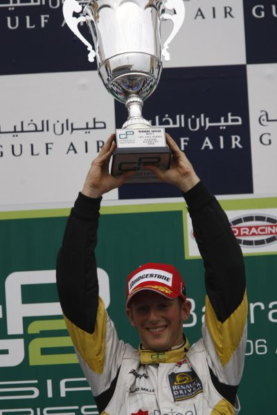 2008 GP2 Asia Series. Saturday Race.Bahrain International Circuit. Sakhir, Bahrain. 5th April. Romain Grosjean (FRA, ART Grand Prix) celebrates victory on the podium. World Copyright: Andrew Ferraro/GP2 Series Media Service. Service ref:__H0Y2655 jpg