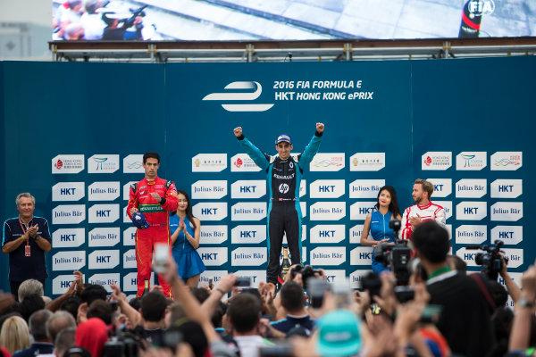 2016/2017 FIA Formula E Championship. Hong Kong ePrix, Hong Kong, China. Sunday 9 October 2016. Lucas Di Grassi (BRA), ABT Schaeffler Audi Sport, Spark-Abt Sportsline, ABT Schaeffler FE02, Sebastien Buemi (SUI), Renault e.Dams, Spark-Renault, Renault Z.E 16 and Nick Heidfeld (GER), Mahindra Racing, Spark-Mahindra, Mahindra M3ELECTRO on the podium. Photo: Andrew Ferraro/LAT/Formula E ref: Digital Image _FER2411