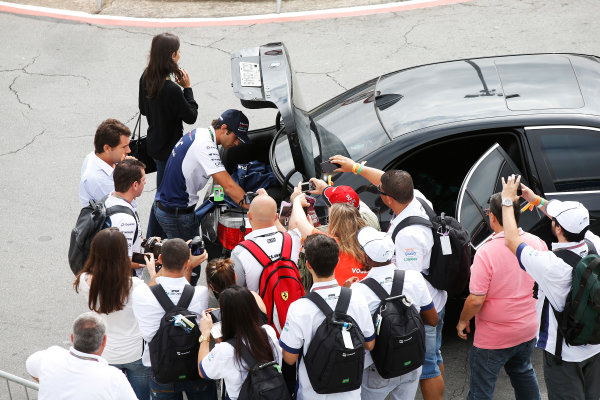 Interlagos, Sao Paulo, Brazil. Sunday 9 November 2014. Felipe Nasr, Test and Reserve Driver, Williams F1, poses for photos with fans. World Copyright: Charles Coates/LAT Photographic. ref: Digital Image _J5R5326