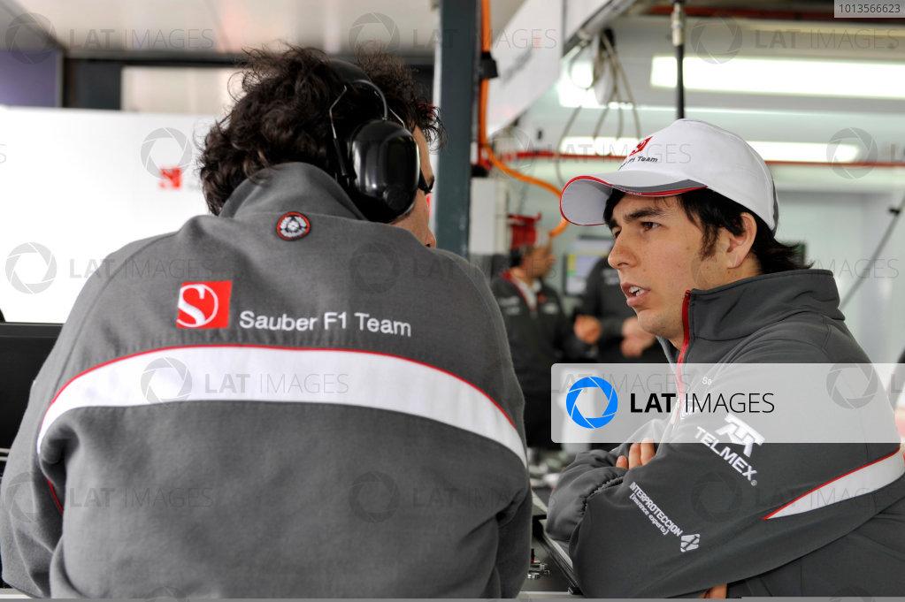 Albert Park, Melbourne, Australia25th March 2011.Sergio Perez, Sauber C30 Ferrari. Talks with a member of the team. Portrait. World Copyright: John Townsend/LAT Photographicref: Digital Image F1pics_Australian_GP_2011_2227
