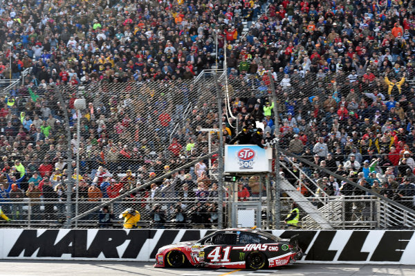 28-30 March, 2014, Martinsville, Virginia USA Kurt Busch takes the win and the checkered flag © 2014, Nigel Kinrade LAT Photo USA