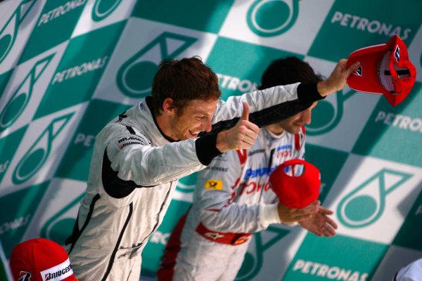 Sepang, Kuala Lumpur, Malaysia5th April 2009Jenson Button, Brawn GP BGP001 Mercedes gives the thumbs up on the podium.World Copyright: Steven Tee/LAT Photographicref: Digital Image _95U0143