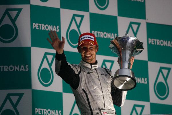 Sepang, Kuala Lumpur, Malaysia 5th April 2009 Jenson Button, Brawn GP BGP001 Mercedes, 1st position, celebrates on the podium. Portrait. Podium.  World Copyright: Andrew Ferraro/LAT Photographic ref: Digital Image _H0Y1394