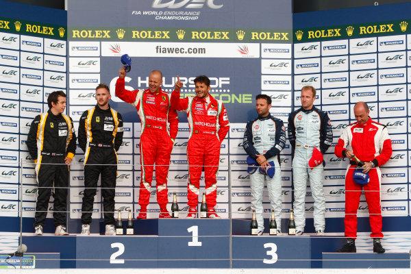 Silverstone, England. 24th - 26th August 2012. Rd 4.GT Pro Podium (l-r) James Walker (GBR)/Jonny Cocker (GBR) JMW Ferrari F458, Giancarlo Fisichella (ITA)/Gianmaria Bruni (ITA) AF Corse Ferrari F458 Italia, Stefan Mucke (DEU)/Adrian Fernandez (MEX)/Darren Turner (GBR) Aston Martin Racing Aston Martin Vantage V8.World Copyright: Ebrey/LAT Photographic.