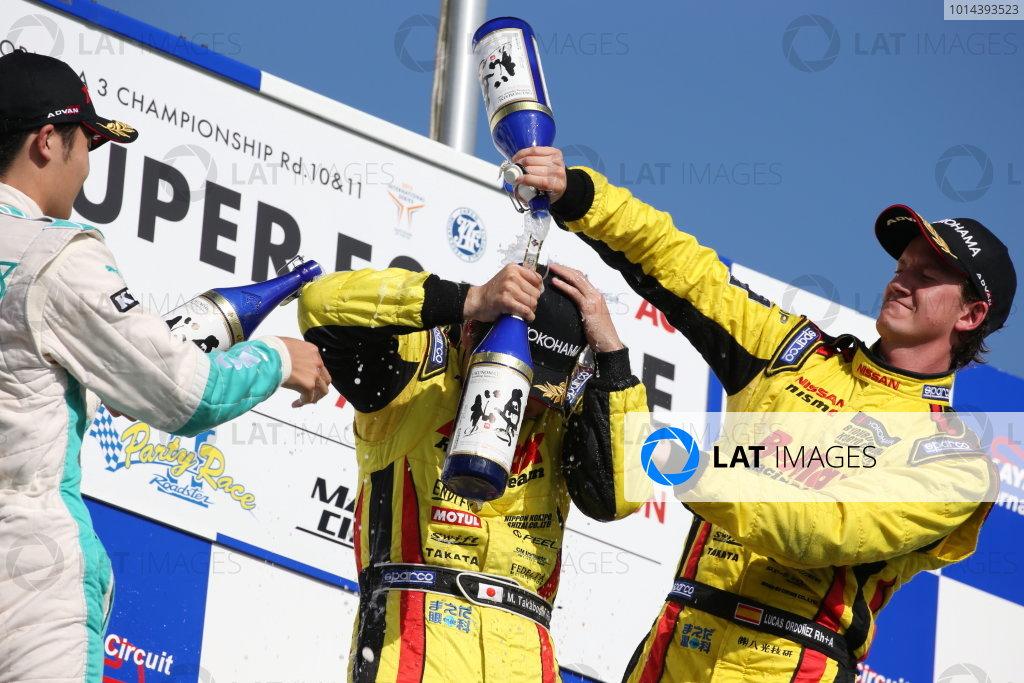 2015 Japanese Formula 3 Championship. Okayama, Japan. 27th - 28th June 2015. Rd 10 & 11. Winner Mitsunori Takaboshi ( #23 B-MAX NDDP F3 ) 2nd position Kenta Yamashita ( #36 PETRONAS TOM'S F312 ) 3rd position Lucas Ordonez ( #22 B-MAX NDDP F3 ) podium, portrait. World Copyright: Masahide Kamio / LAT Photographic. Ref:  2015JF3_Rd10&11_06