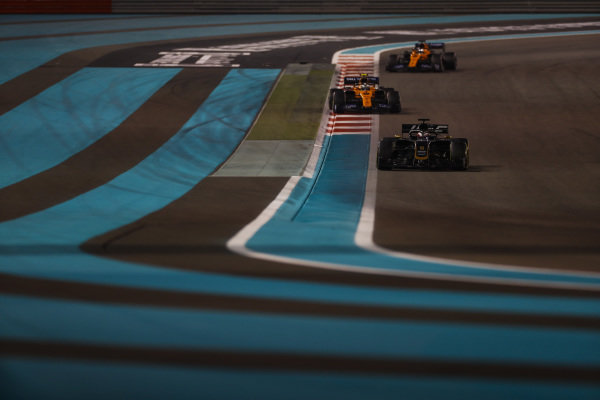 Romain Grosjean, Haas VF-19, leads Lando Norris, McLaren MCL34, and Carlos Sainz Jr., McLaren MCL34