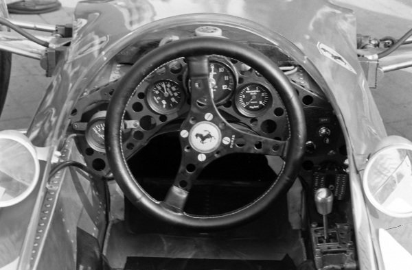 The steering wheel and dash of the Ferrari 246.