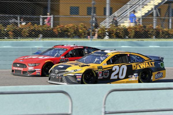 #20: Erik Jones, Joe Gibbs Racing, Toyota Camry DeWalt, #41: Daniel Suarez, Stewart-Haas Racing, Ford Mustang Haas Automation