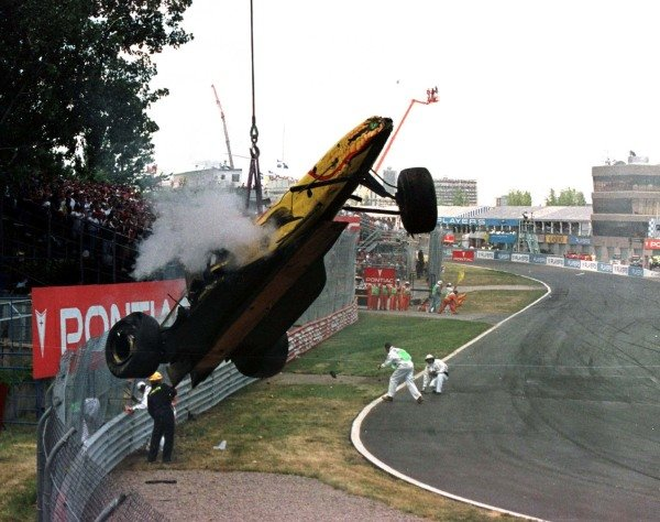 1997 Canadian Grand Prix.Montreal, Quebec, Canada.13-15 June 1997.The wreckage is removed after Ralf Schumacher (Jordan 197 Peugeot) crashed heavily.World Copyright - LAT Photographic