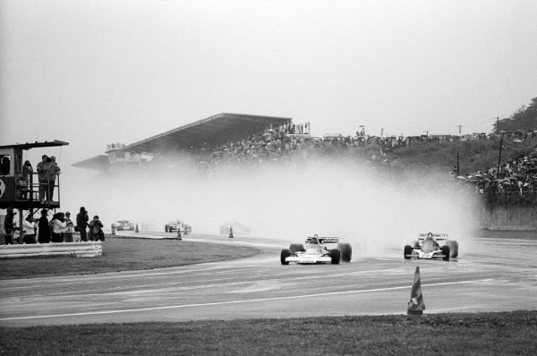 James Hunt (GBR) McLaren leads at the start of the race held in dreadful conditions. In dramatic style he finished in third position and took the World Championship. Japanese Grand Prix, Rd 16, Fuji, Japan, 24 October 1976.