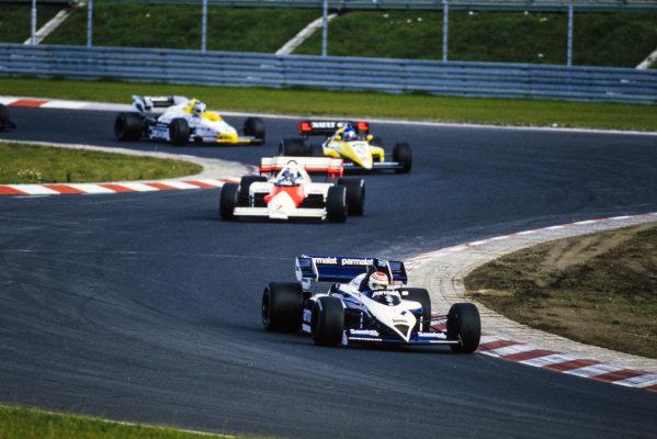 Nelson Piquet, Brabham BT53 BMW, leads Alain Prost, McLaren MP4-2 TAG, Patrick Tambay, Renault RE50, and Keke Rosberg, Williams FW09B Honda.