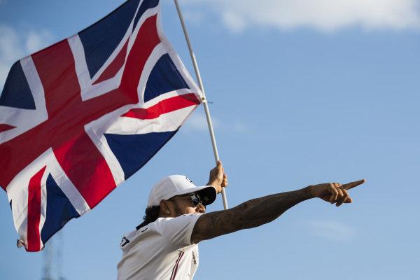 Lewis Hamilton, Mercedes AMG F1, 1st position, celebrates with a Union flag