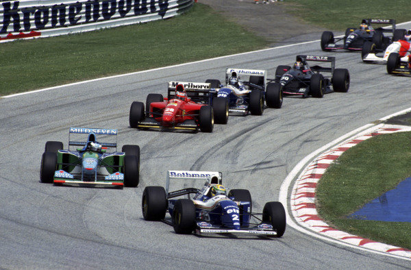 Ayrton Senna, Williams FW16 Renault, leads Michael Schumacher, Benetton B194 Ford, Gerhard Berger, Ferrari 412T1, Damon Hill, Williams FW16 Renault, and Heinz-Harald Frentzen, Sauber C13 Mercedes.