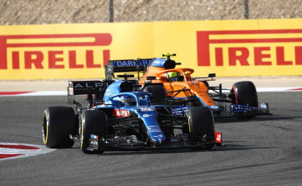 Fernando Alonso, Alpine A521, leads Lando Norris, McLaren MCL35M