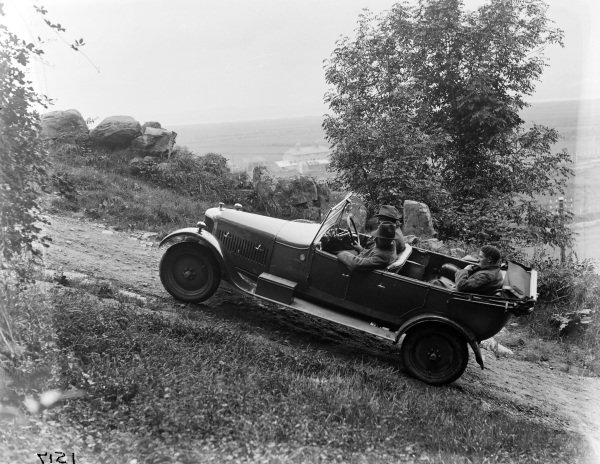 AC driving up a steep hill.