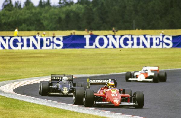 Michele Alboreto, Ferrari 156/85, leads Elio de Angelis, Lotus 97T Renault, and Alain Prost, McLaren MP4-2B TAG.