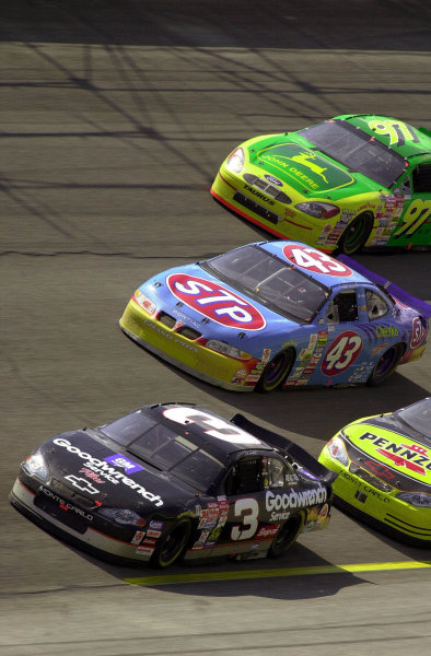 Dale Earnhardt leads the cars of John Andretti (#43), Chad Little (#97) and Steve Park (hidden) through turn 1.NASCAR DieHard 500 at Talladega Superspeedway 16 April,2000 LAT PHOTOGRAPHIC-F Peirce Williams 2000