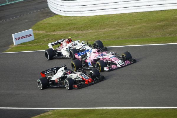 Romain Grosjean, Haas F1 Team VF-18, battles with Sergio Perez, Racing Point Force India VJM11 and Charles Leclerc, Sauber C37 Ferrari