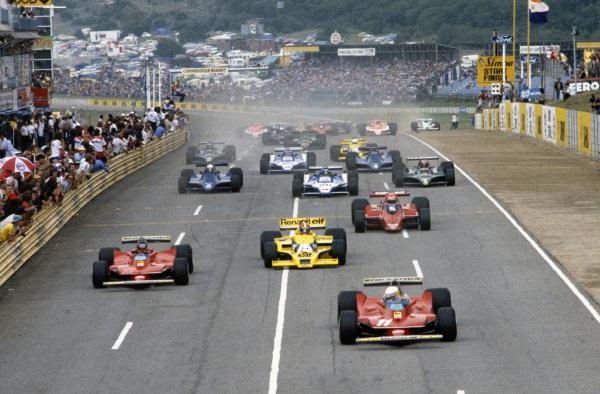 Jody Scheckter, Ferrari 312T4 and team mate Gilles Villeneuve, Ferrari 312T4 get the jump on pole sitter Jean-Pierre Jabouille, Renault RS01 at the start.