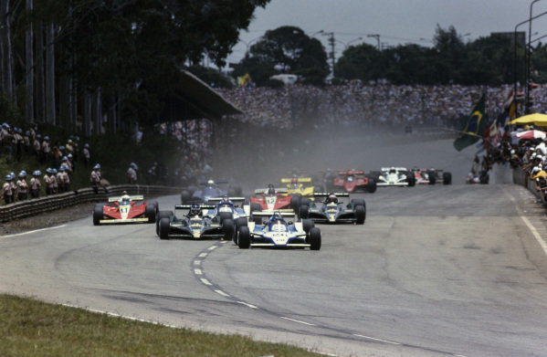 Pole sitter Jacques Laffite, Ligier JS11 Ford, leads the field at the start of the race.