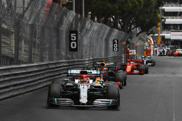 Lewis Hamilton, Mercedes AMG F1 W10, leads Max Verstappen, Red Bull Racing RB15, and Sebastian Vettel, Ferrari SF90
