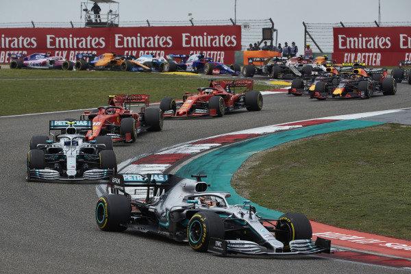 Lewis Hamilton, Mercedes AMG F1 W10, leads Valtteri Bottas, Mercedes AMG W10, Charles Leclerc, Ferrari SF90, Sebastian Vettel, Ferrari SF90, and Max Verstappen, Red Bull Racing RB15, on the opening lap