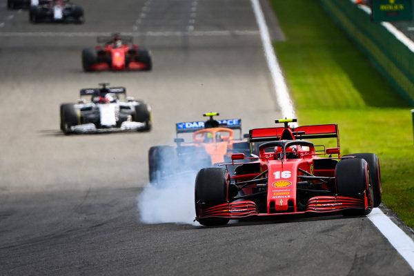Charles Leclerc, Ferrari SF1000, locks up whilst defending from Lando Norris, McLaren MCL35