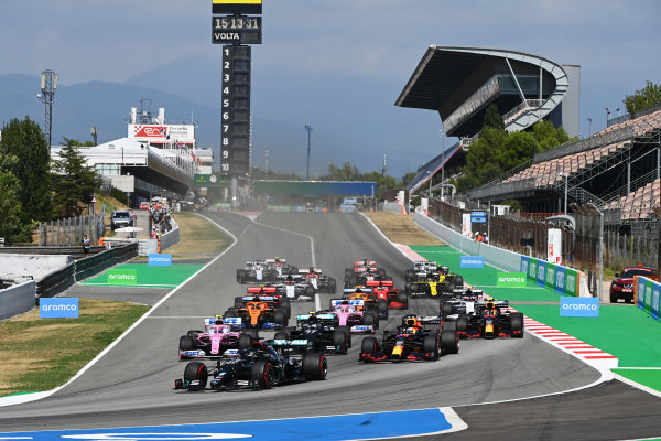Lewis Hamilton, Mercedes F1 W11 EQ Performance, leads Valtteri Bottas, Mercedes F1 W11 EQ Performance, Max Verstappen, Red Bull Racing RB16, Lance Stroll, Racing Point RP20, Sergio Perez, Racing Point RP20, and the rest of the field at the start
