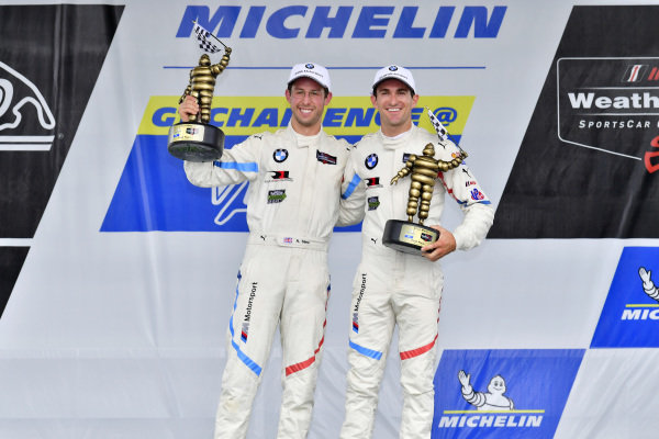 #25 BMW Team RLL BMW M8, GTLM: Alexander Sims, Connor de Phillippi celebrate the win on the podium