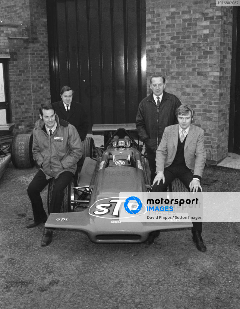 The founding directors of March Engineering, back row Alan Rees(GBR) left, and Graham Coaker(GBR), front row Robin Herd(GBR) left, and Max Mosley(GBR)  with the new March 701 F1 car outside the March factory Bicester, Oxfordshire, in 1970